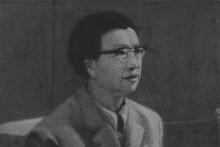 ZHANG HUAN : JIANG QING IN SUIT